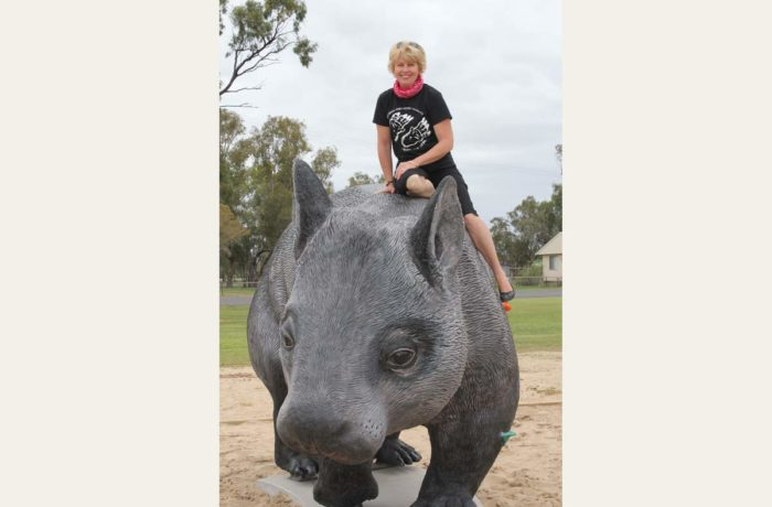 Hopes of tiny outback community rest on shoulders of giant wombat